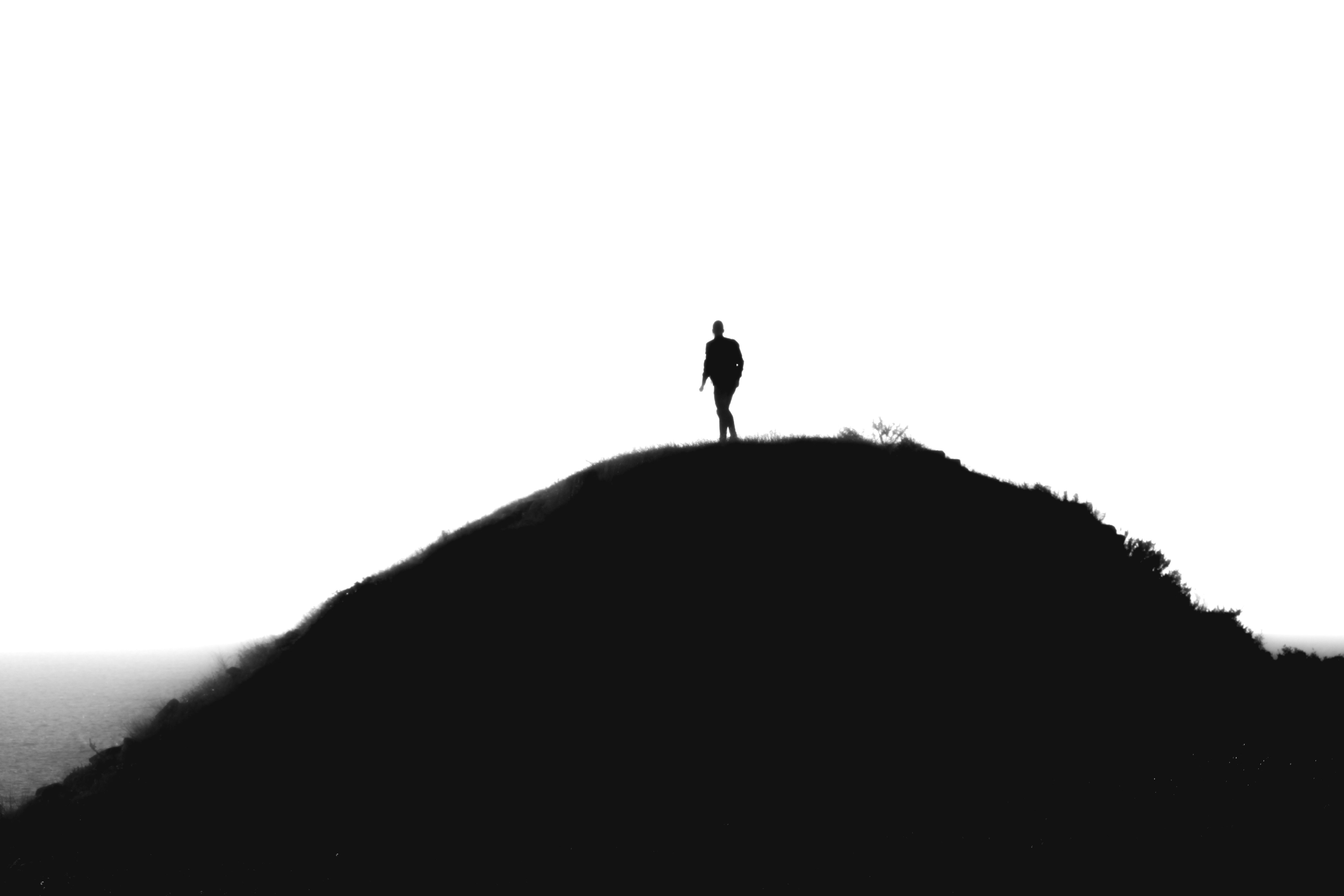 a man walking on the mountain